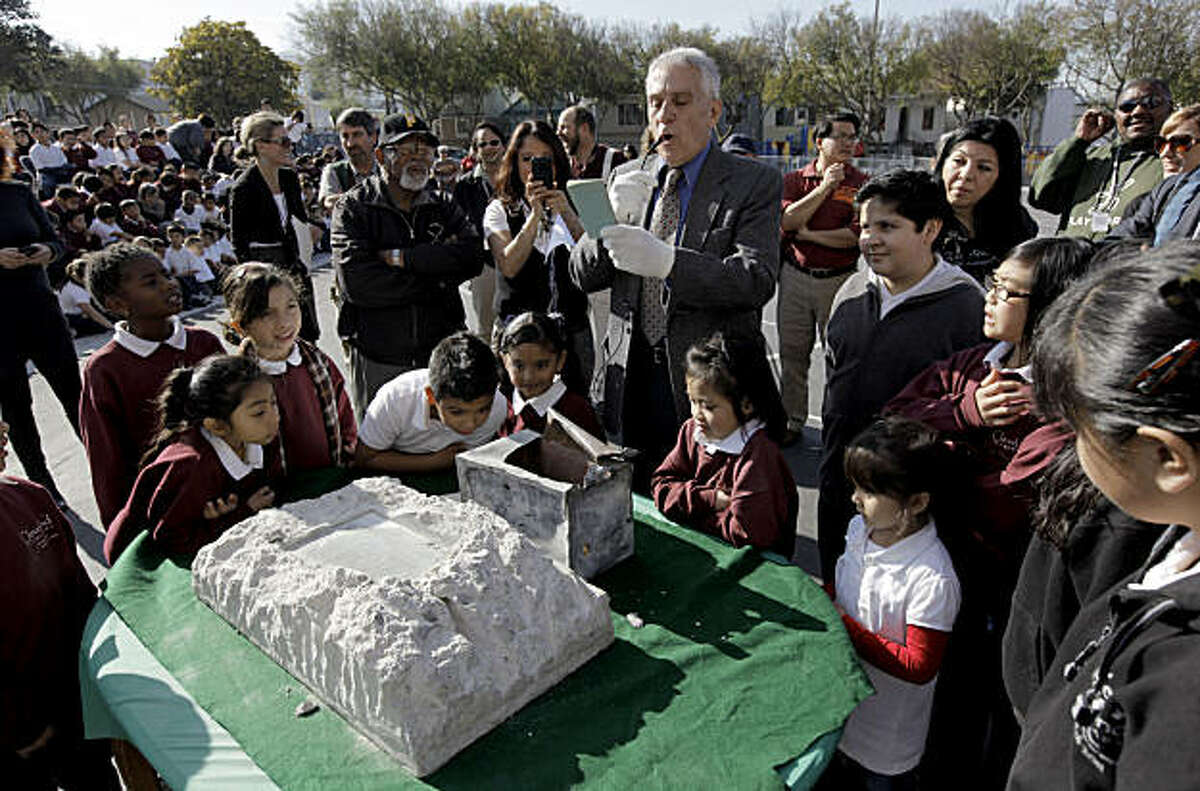 John Weidinger, the person who discovered the location of the 100-year-old time capsule, displays the contents found inside during a ceremony at Cleveland Elementary School on Wednesday Jan, 25, 2011, in San Francisco, Ca.