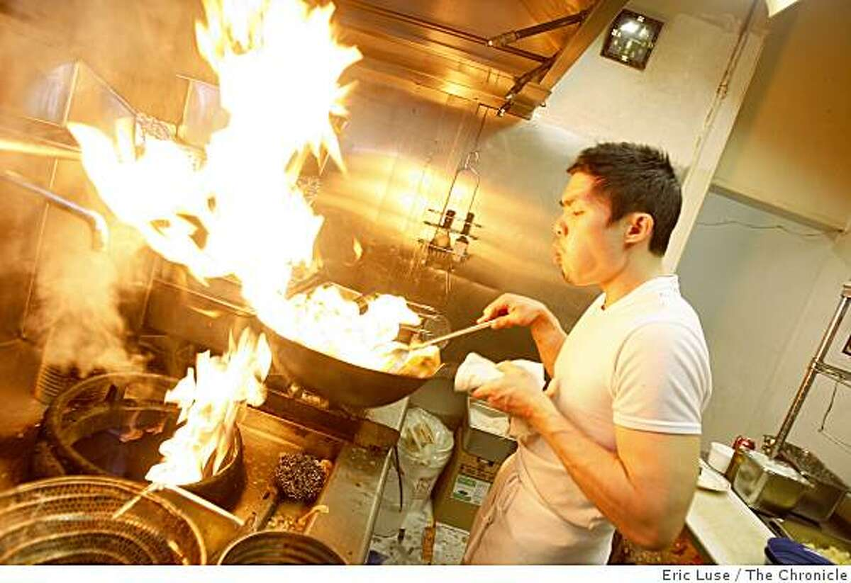 Co-founder Anthony Myint takes over half the kitchen while cooking at Mission Street Food which converts at night in the Lung Shan Restaurant in the Mission District of San Francisco photographed on Thursday, February 12, 2009.