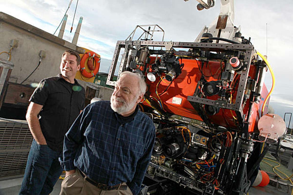 From Left, video lab research technician Lonny Lundsten, and senior scientist Bob Vrijenhoek pose for a portrait in front of the remotely operated vehicle (ROV)