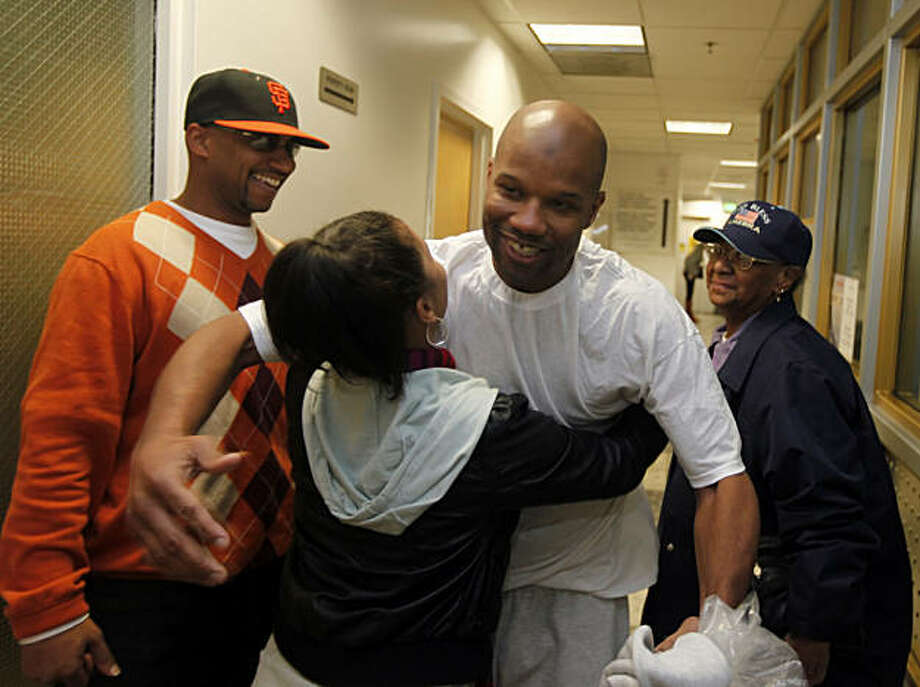 Family members hug Caramad Conley, who a judge said last month had been wrongfully convicted of a 1989 double murder in San Francisco.  Conley walked out of San Francisco County jail Wednesday Jan 12, 2011 a free man. San Francisco's new DA George Gascon decided not to retry him. Photo: Lance Iversen, The Chronicle