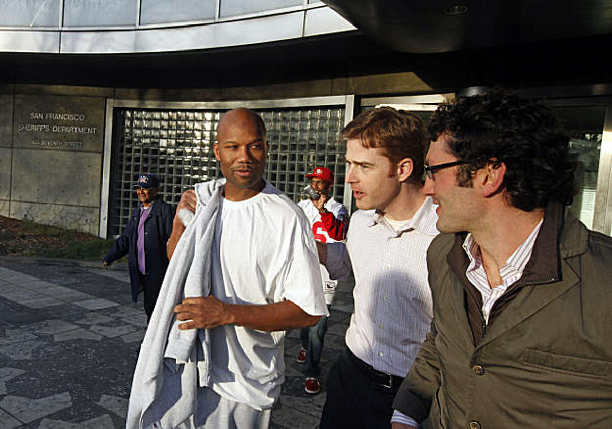 Attorneys Daniel Purcell, center, and Zachary F. Bookman, right, walked Caramad Conley, left, out of San Francisco County Jail Wednesday Jan 12, 2011 after a judge said last month That Conley had been wrongfully convicted of a 1989 double murder in San Francisco.