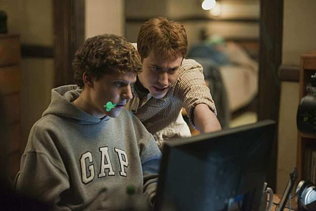 FILE - In this file publicity image released by Columbia Pictures, Jesse Eisenberg, left, and Joseph Mazzello are shown in a scene from