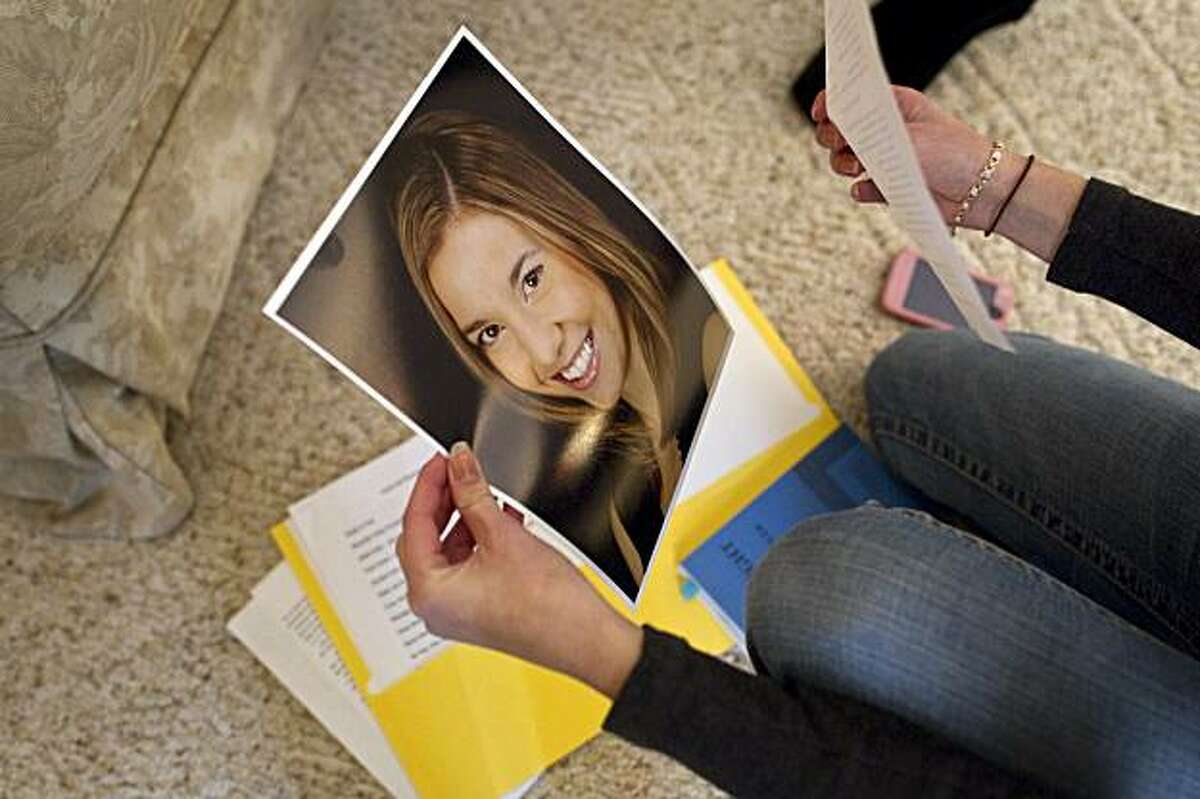 Taylor Hix, age 17, arranges her audition materials while attending a workshop to help her and other high school students prepare for college theater program auditions in Burlingame, Calif., on Saturday, January 8, 2011.