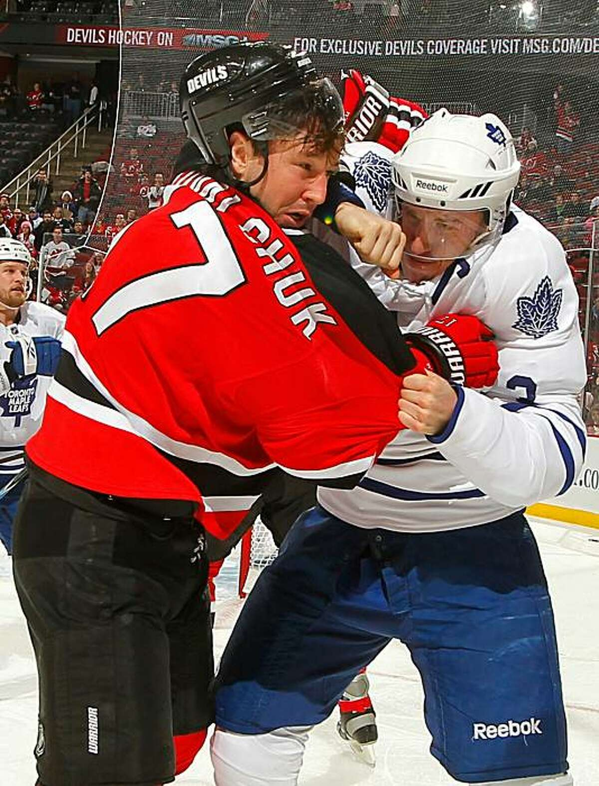 NEWARK, NJ - DECEMBER 26: Dion Phaneuf #3 of the Toronto Maple Leafs fights with Ilya Kovalchuk #17 of the New Jersey Devils in the second period of an NHL hockey game at the Prudential Center on December 26, 2010 in Newark, New Jersey.