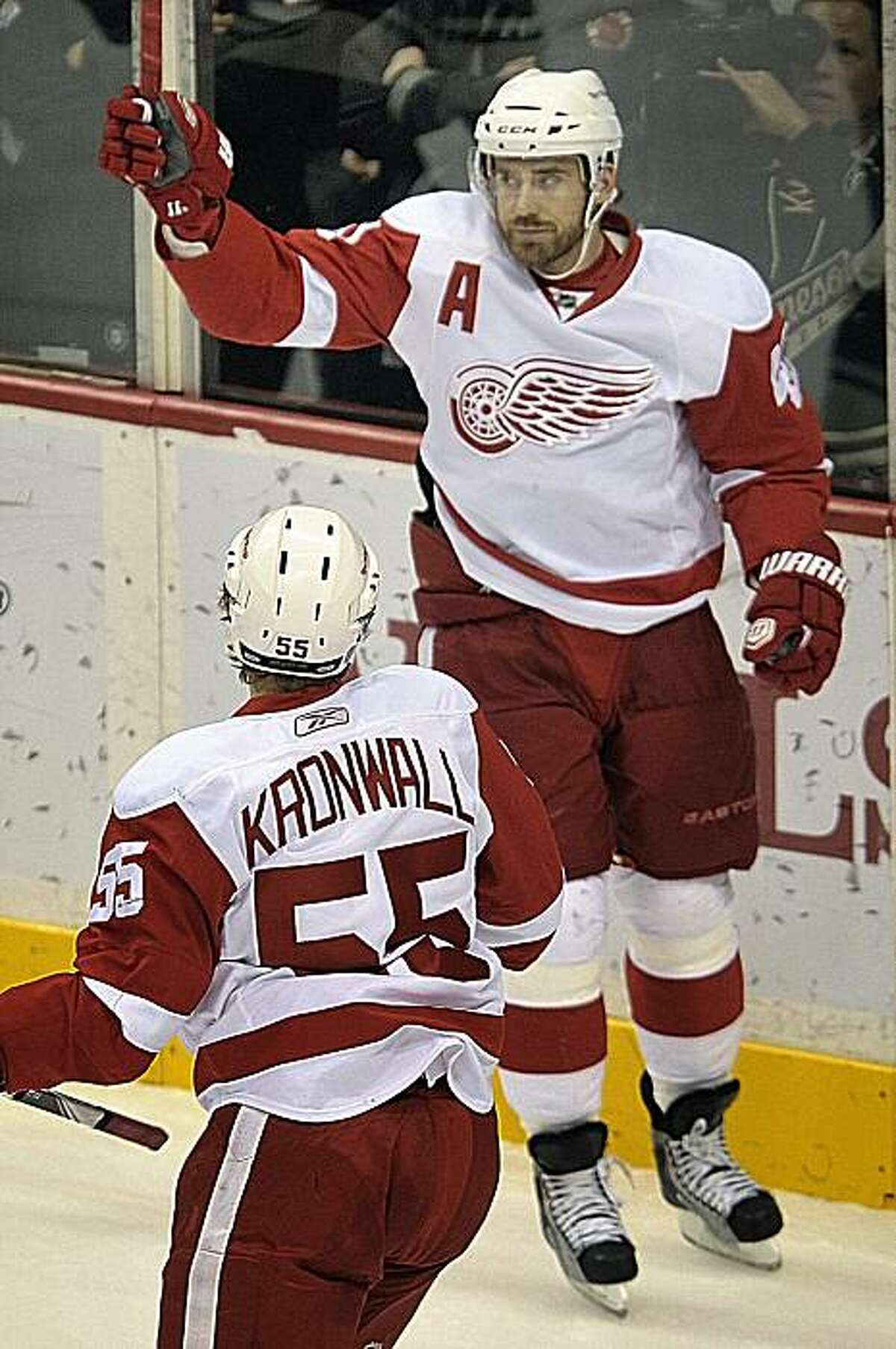Detroit Red Wings' Henrik Zetterberg, right, of Sweden, celebrates his goal with teammate Niklas Kronwall (55), of Sweden, during the first period of an NHL hockey game against the Minnesota Wild on Sunday, Dec. 26, 2010, in St. Paul, Minn. Detroit won 4-1.