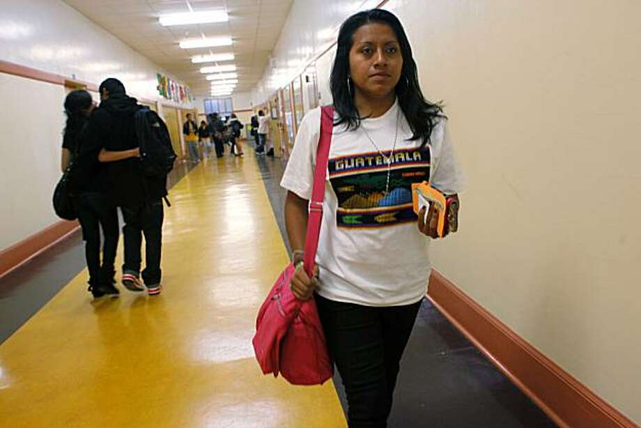 Ana Avalos, an 18-year-old senior of Mission High School walks to AP Biology class on Friday January. 14, 2011 in San Francisco, Calif.  Four years ago Avalos moved to San Francisco from Guatemala and in that time mastered English and now has applied to 11 colleges with the hopes of becoming a biology major at one of them next year. She will be the first person in her family to not only go to college but graduate from high school as well. Photo: Mike Kepka, The Chronicle