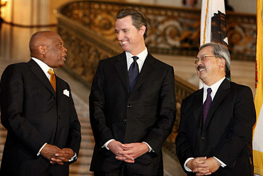 Three mayors, Willie Brown (left) Gavin Newsom (center) and Ed Lee enjoy a light moment at City Hall on Tuesday. Photo: Brant Ward, The Chronicle