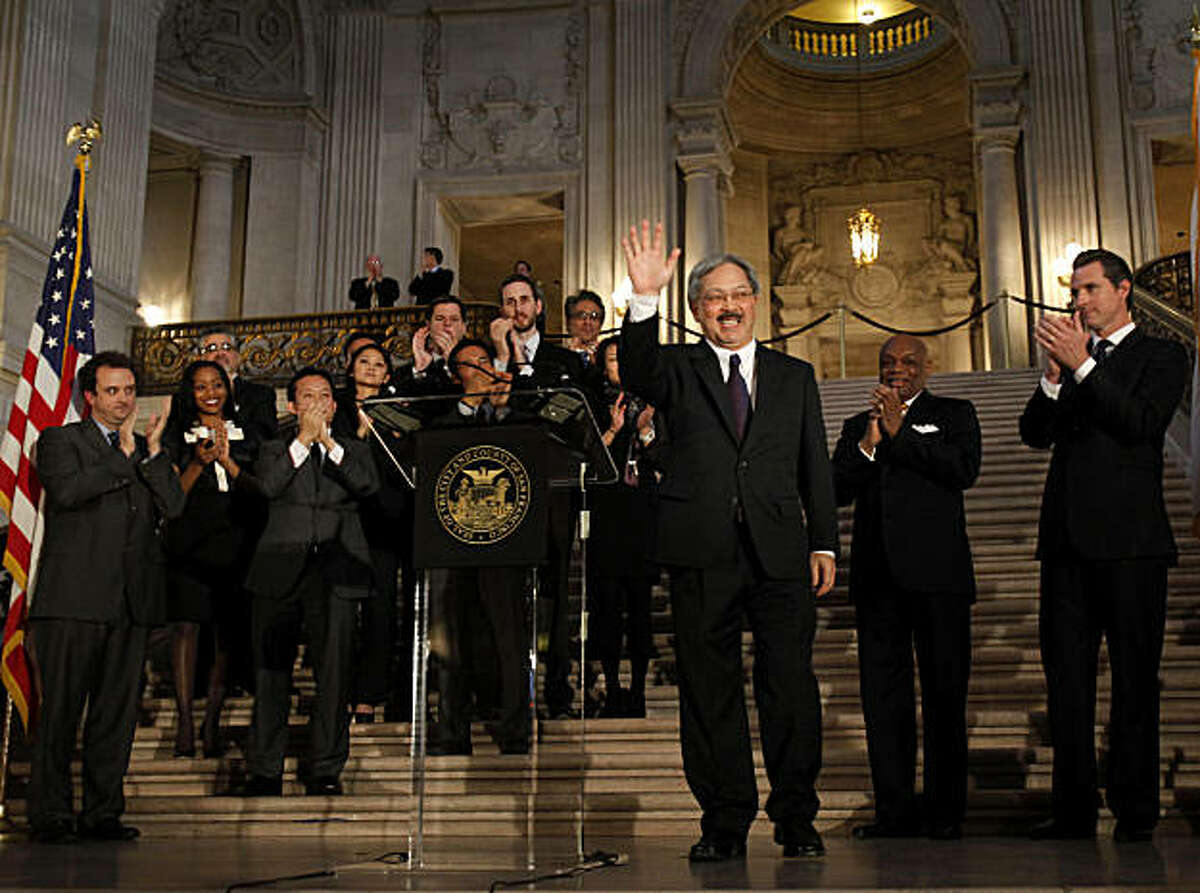 Ed Lee waves to the crowd at City Hall after being sworn in as mayor of San Francisco on Tuesday.