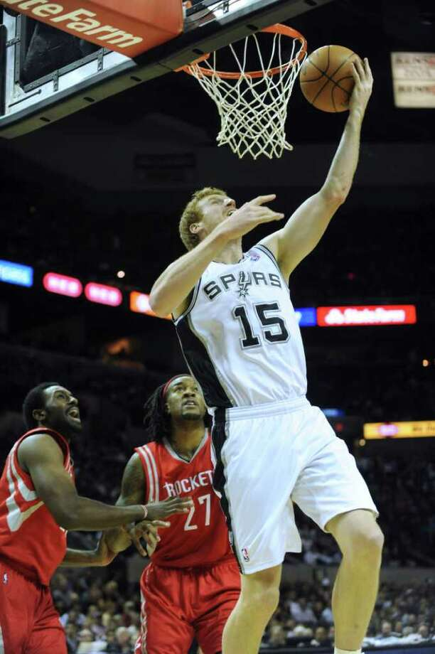 Matt Bonner of the San Antonio Spurs makes a reverse layup during first-half NBA action against the Houston Rockets at the AT&T Center on Wednesday, Jan. 11, 2012. BILLY CALZADA / gcalzada@express-news.net