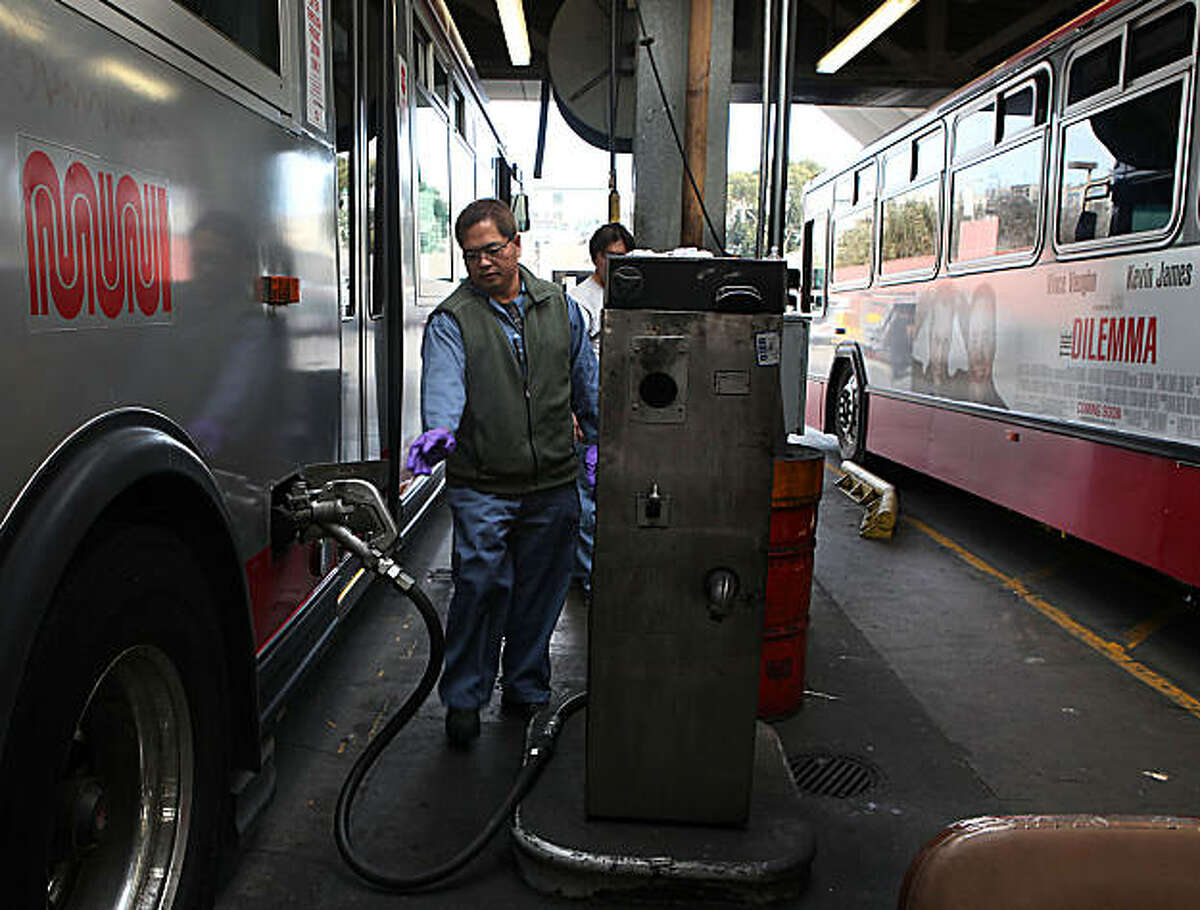 Service Muni employee Eduardo Manag fills a bus tank at the biodiesel pump at the Woods division in San Francisco, Calif., on Monday, January 24, 2011.Service Muni employee Eduardo Manag fills a bus tank at the biodiesel pump at the Woods division in San Francisco, Calif., on Monday, January 24, 2011.