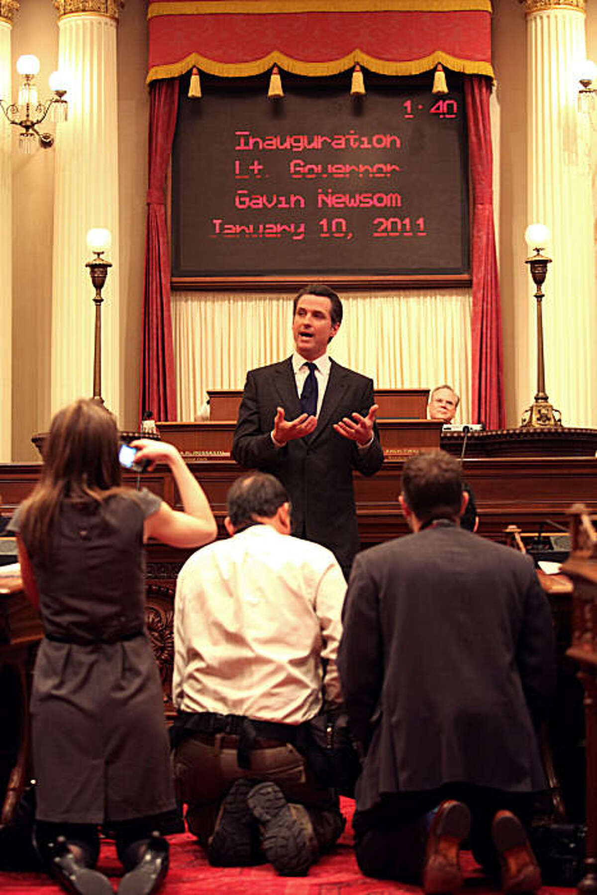 Mayor Gavin Newsom speaks after getting sworn in as lieutenant governor by his father, Hon. Judge William Newsom (left) at the state capitol in Sacramento, Calif., on Monday, January 10, 2011.