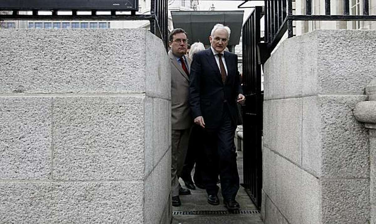 Green Party leader John Gormley, front, and party members walk out of government Buildings, Dublin, Ireland, Sunday Jan. 23, 2011. Ireland's Green Party has withdrawn from the Irish government, raising pressure for Prime Minister Brian Cowen to resign from office and for Ireland to hold a national election sooner than March 11 as planned.