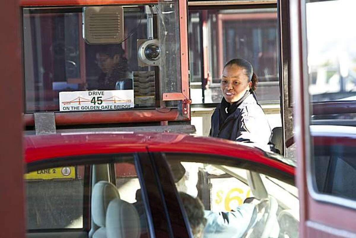 Angela Adams collects a toll from a motorist while working as a toll collector at the Golden Gate Bridge in San Francisco, Calif., on Monday, January 10, 2011.