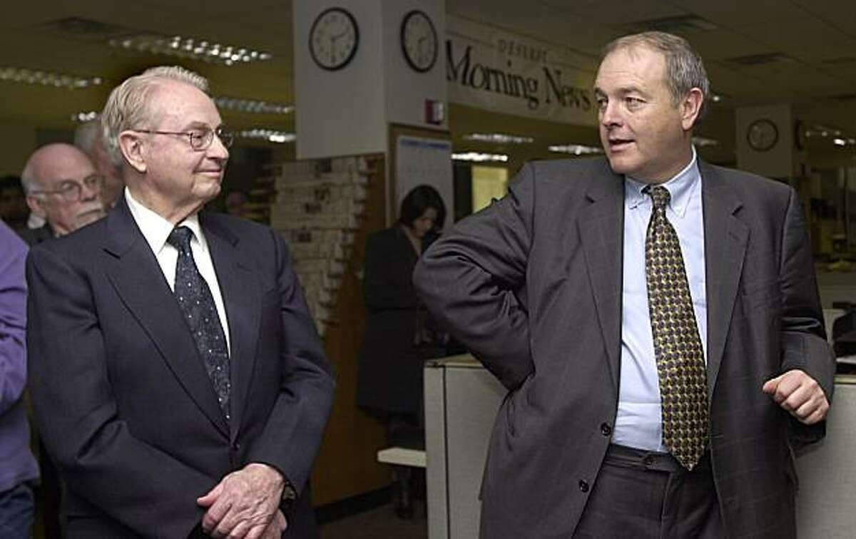 Deseret Morning News board chairman Glenn Snarr, left, and MediaNews president Dean Singleton answer questions during the introduction of former Cincinnati Enquirer president and publisher Harry Whipple to the editorial staff of the Deseret Morning News in his new role as president of the Newspaper Agency Corporation, Monday, Feb. 23, 2004, in Salt Lake City. The NAC handles the advertising and circulation of the paper and that of The Salt Lake Tribune. Singleton is also publisher of the Tribune.