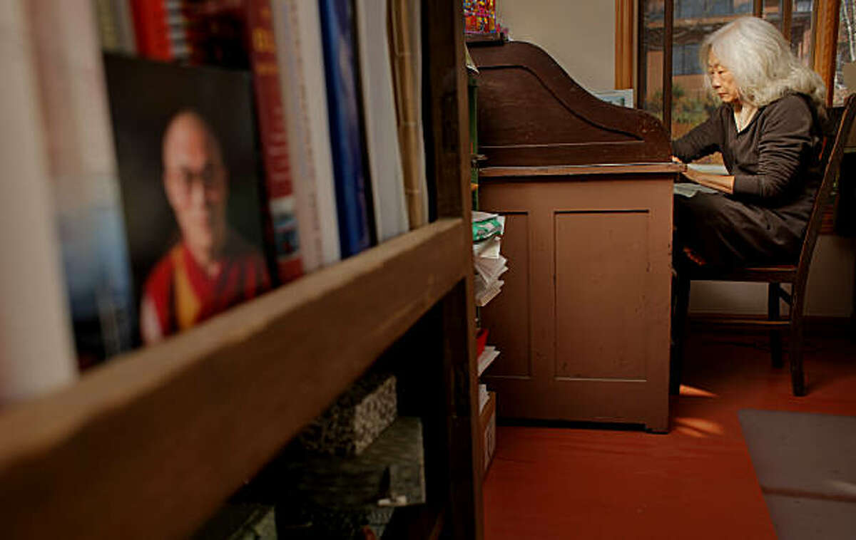 Maxine Hong Kingston writes a letter at her fathers desk in her casita, Monday January 17, 2011, at her home in Oakland,Calif.