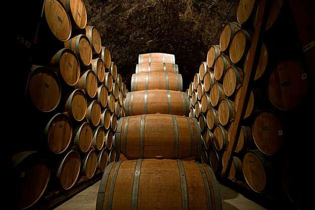 Barrels of zinfandel are piled high deep within the historic cellar of Ridge Vineyards on Wednesday, February 17, 2010. Photo: Chad Ziemendorf, Special To The Chronicle