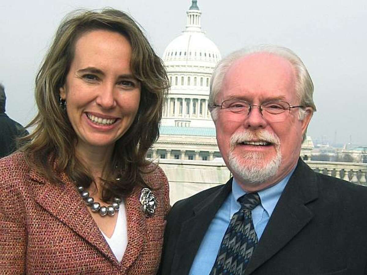 This February, 2010 photo provided by the office of Rep. Gabrielle Giffords shows the congresswoman posing for photos with Ron Barber, district director for Giffords, right. Barber was injured on Saturday, Jan. 8, 2011 when a gunman opened fire at a political event with Rep. Giffords in Tucson, Ariz.