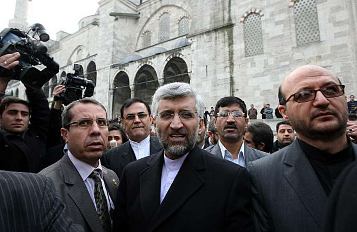 Iran's Chief Nuclear negotiator Saeed Jalili, center, leaves Ottoman-era Sultan Ahmed Mosque after he attended Friday prayers there following the for round of talks between Iran and world powers on Iran's nuclear program at the historical Ciragan Palace in Istanbul, Turkey, Friday, Jan. 21, 2011. Iran and six world powers sought common ground Friday at talks jeopardized by Tehran's refusal to discuss demands for curbs on nuclear activities that could enable it manufacture the fissile core of nuclear warheads. As the two sides broke for lunch, with the Iranians dining separately, there was no sign of movement from either side from widely differing positions revealed after a first round of talks in Geneva last month.