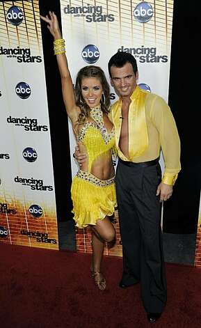 "Contestant Audrina Patridge, left, and her dance partner Tony Dovolani pose together following the 11th season premiere of ""Dancing with the Stars,"" Monday, Sept. 20, 2010. Photo: Chris Pizzello, AP"