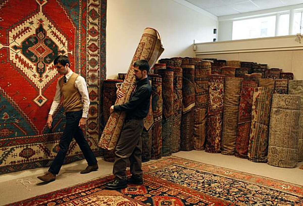 Daniel Larkin and Brian James remove an antique rug from one of several show rooms at Claremont Rug Company. Jan David Winitz is the owner/president/founder of Claremont Rug Company, which is the leading dealer of antique (19th century), art-level Oriental rugs in the world. From his small gallery in Oakland he has built a 3,500-rug inventory of pieces, which sell for from $20,000 to more than $700,000 per carpet. Winitz was introduced to rugs by his grandmother when he was 6-7 years in New York. While other kids were trading baseball cards, Jan David was studying rugs and learning to identify weaving groups, etc. He bought his first rug when he was a teenager and started Claremont 30 years ago (after graduating from UC Berkeley) and teaching English for a couple of years.Tuesday Jan 11, 2011.