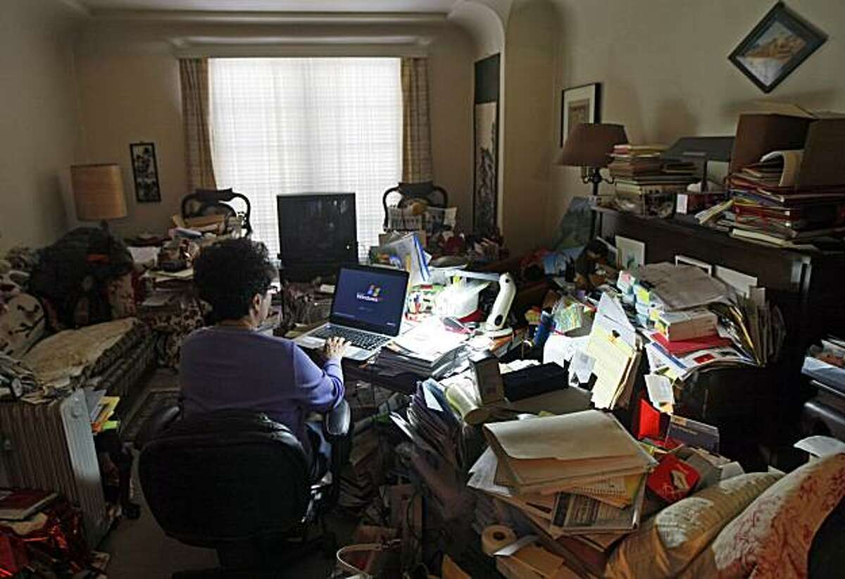 A San Francisco homeowner uses her livingroom as her home office that filled with years of accumulated clutter Thursday Jan 6, 2011.