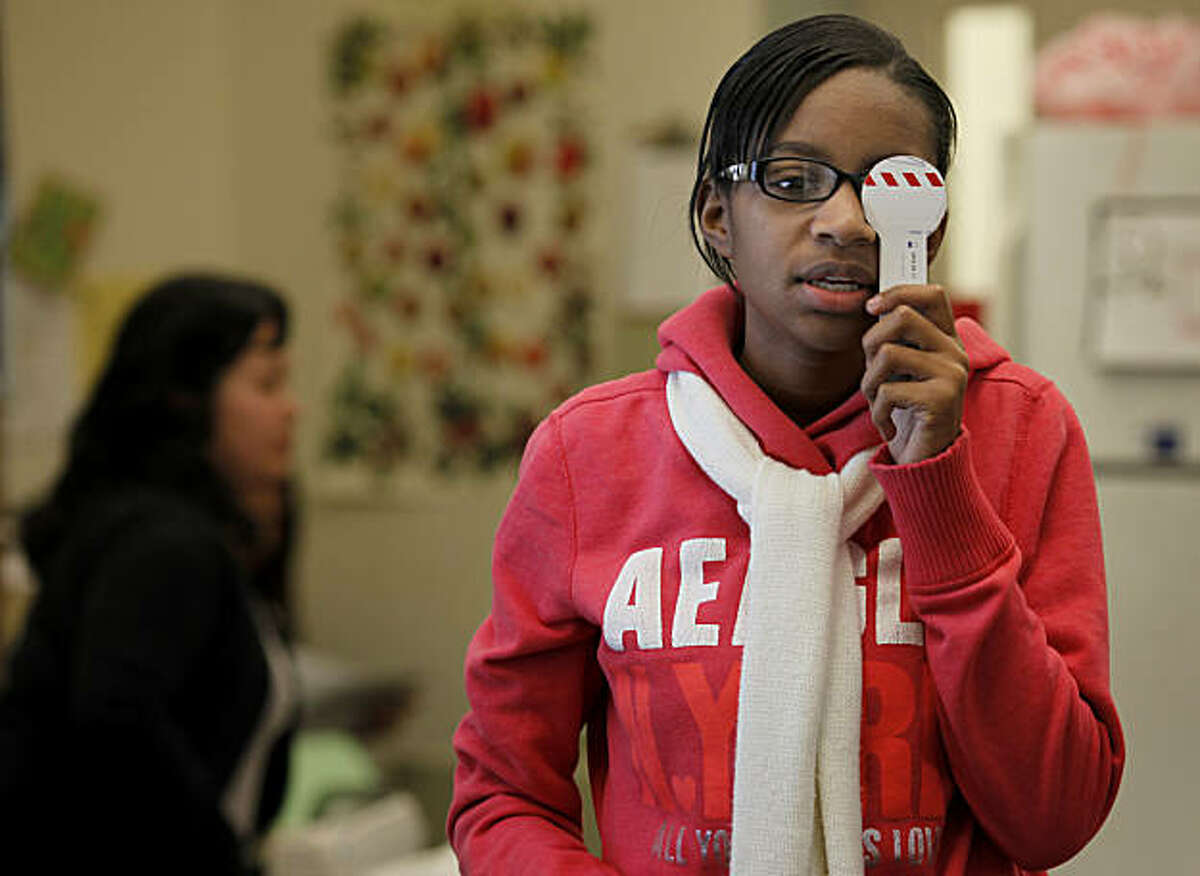 Tenth grader Kendall Walton takes her eye test as part of a sports physical Thursday January 13, 2011 at the Oakland High Wellness Center. School clinics like the Oakland High School Wellness Center are finding it difficult to get funding these days and state funding cutbacks are not helping.