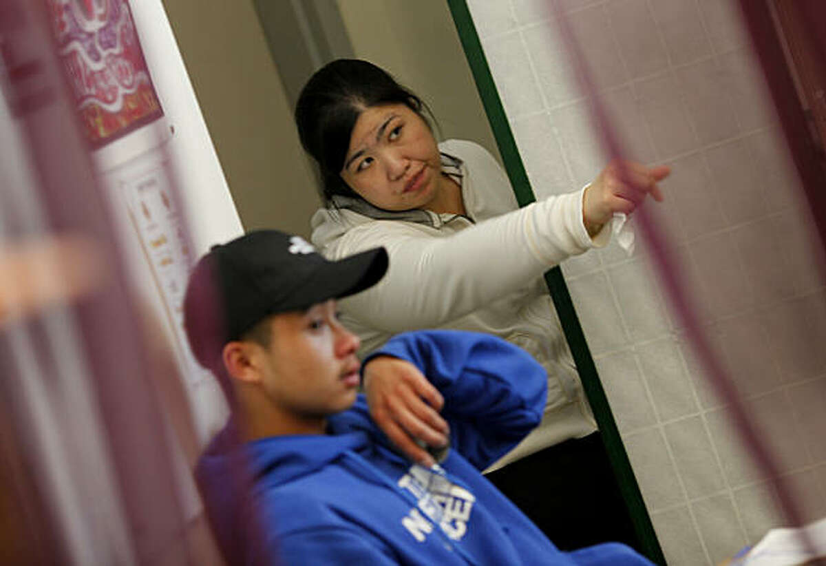 Medical assistant Dorothy Ngo (right) directs student Kevin Saefong during his visit to the clinic Thursday January 13, 2011. School clinics like the Oakland High School Wellness Center are finding it difficult to get funding these days and state funding cutbacks are not helping.