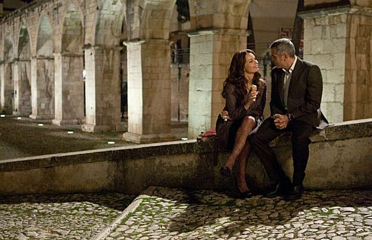 Violante Placido (left) and George Clooney (right) star in director Anton Corbijn?•s suspense thriller THE AMERICAN, a Focus Features release.