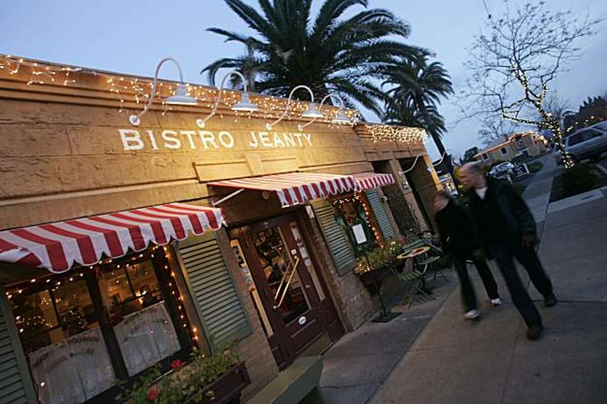 Visitors stroll past Bistro Jeanty, a French-themed restaurant on the main drag in Yountville, Calif. Bistro Jeanty is one of a few dozen businesses offering