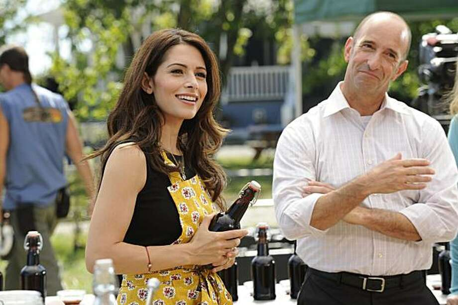 "FAIRLY LEGAL -- ""BO ME ONCE"" Episode 104 -- Pictured: (l-r) Sarah Shahi as Kate Reed, Rob Labelle as Frank Griffin . Photo: Alan Zenuk, USA Network"