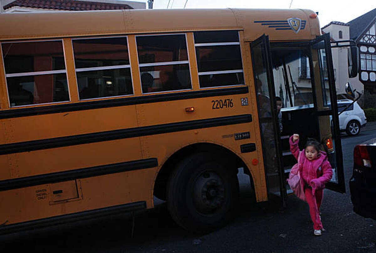Children disembark from a school bus as they arrive for school at Alice Fong Yu Elementary School on Thursday, December 16, 2010 in San Francisco, Calif.Children disembark from a school bus as they arrive for school at Alice Fong Yu Elementary School on Thursday, December 16, 2010 in San Francisco, Calif.