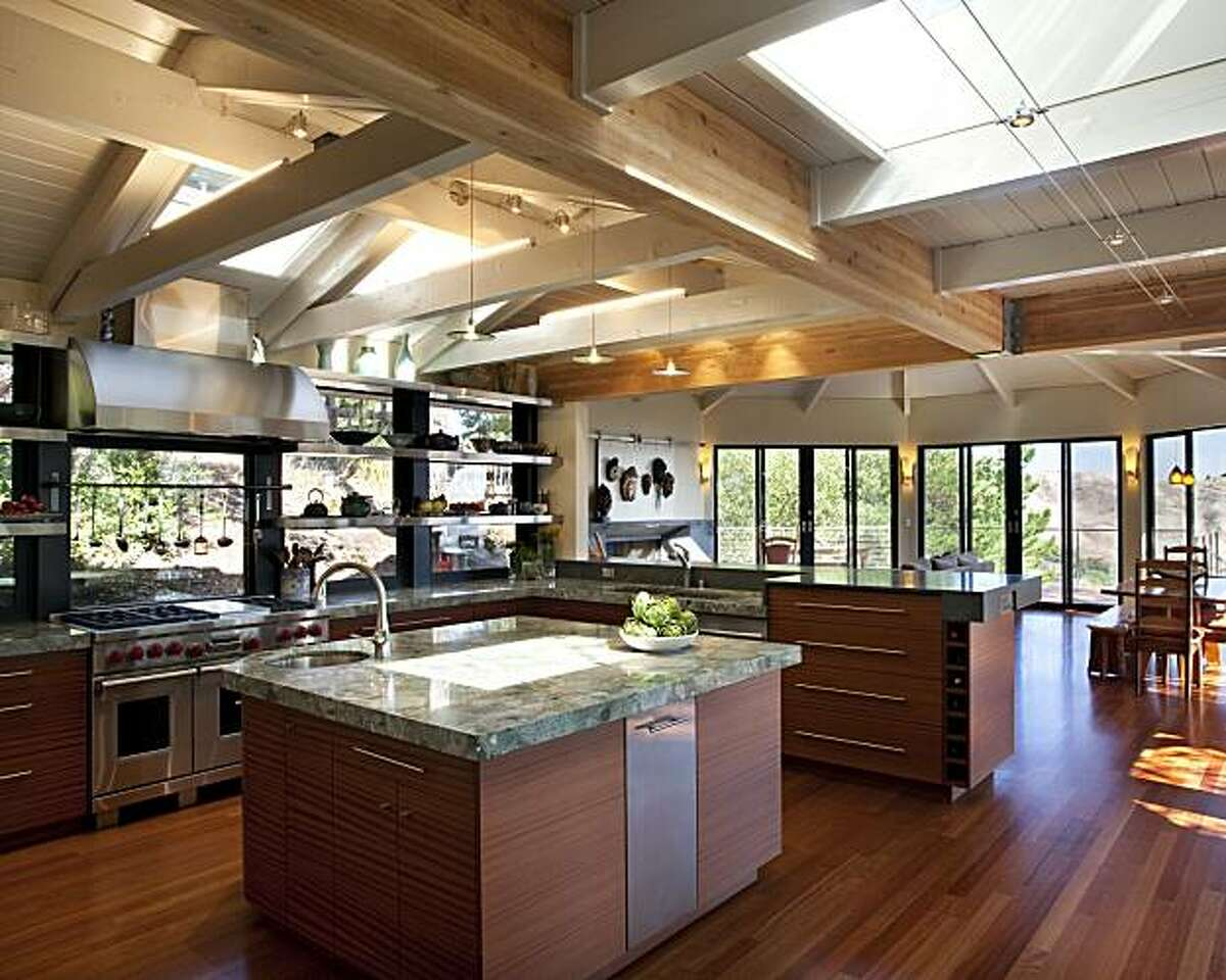 The remodeled kitchen, which now opens into the octagonal living room in Charles and Jane Long's Oakland hills home.