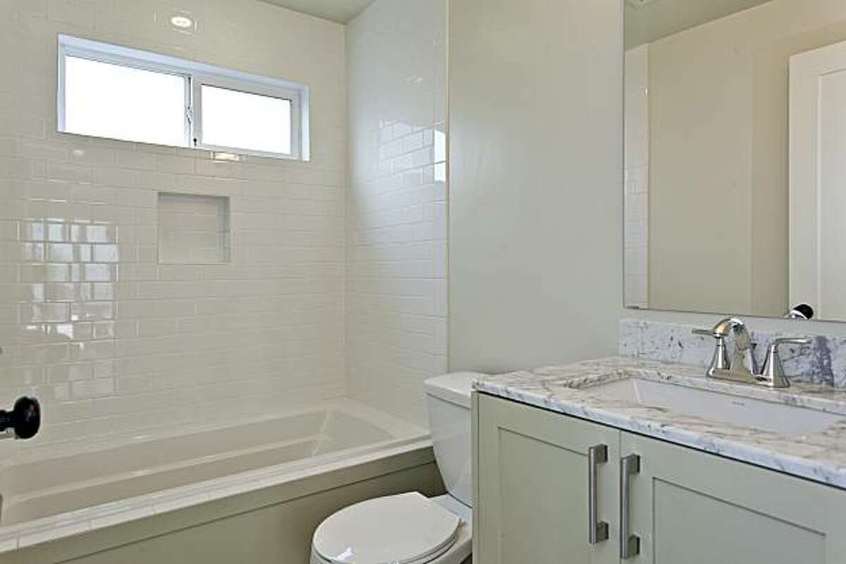The lower level unit bathroom. The two-story bungalow is offered as a duplex with a lower level au pair suite.