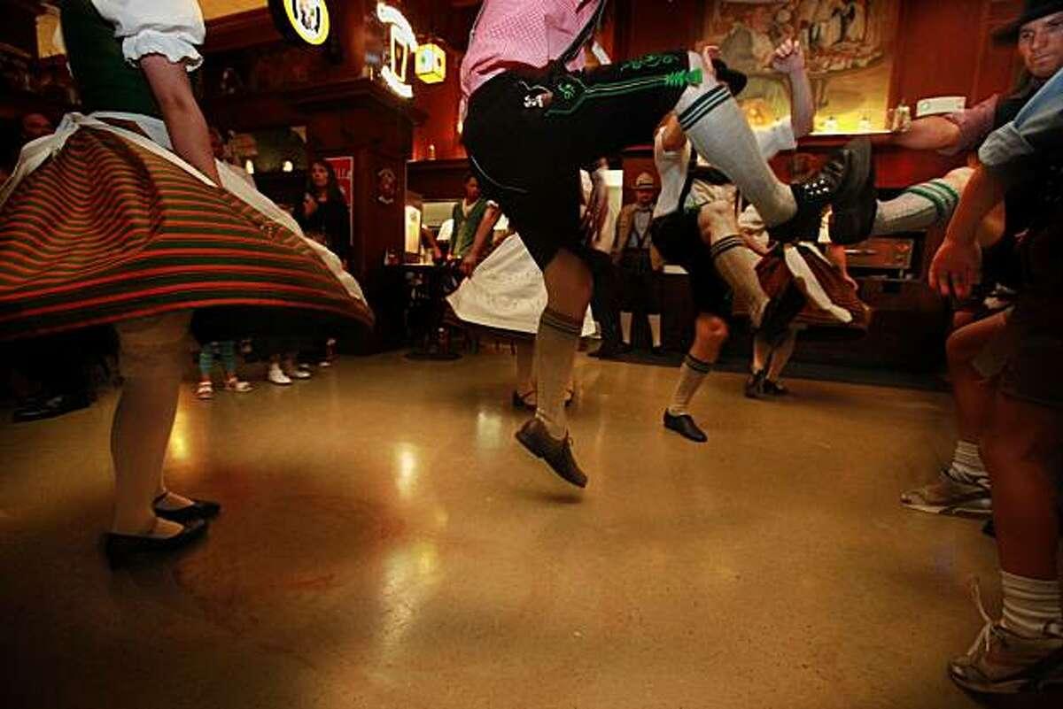Toe tapping - 7:30 p.m. - San Francisco. Loved the Oktoberfestive scene as the Golden Gate Bavarian club danced Schuhplattler to Joe Smiell's band at Schroeder's German Restaurant. Canon EOS 5D Mark II, ISO2500, 1/30, f4.5, 16mm. ISO: 2500 Aperture: 4.5 Shutter: 1/30