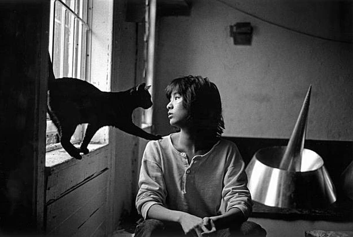 Vietnam Memorial architect Maya Lin with her cat in her New York studio, 1986.
