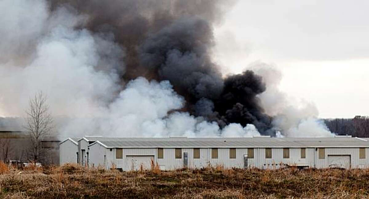 Smoke from a fire rises from a building at the Kinematics Research plant in Oakland, Tenn., Wednesday, Jan. 5, 2011. The plant makes ammunition for firearms. Witnesses also reported hearing a series of explosions.
