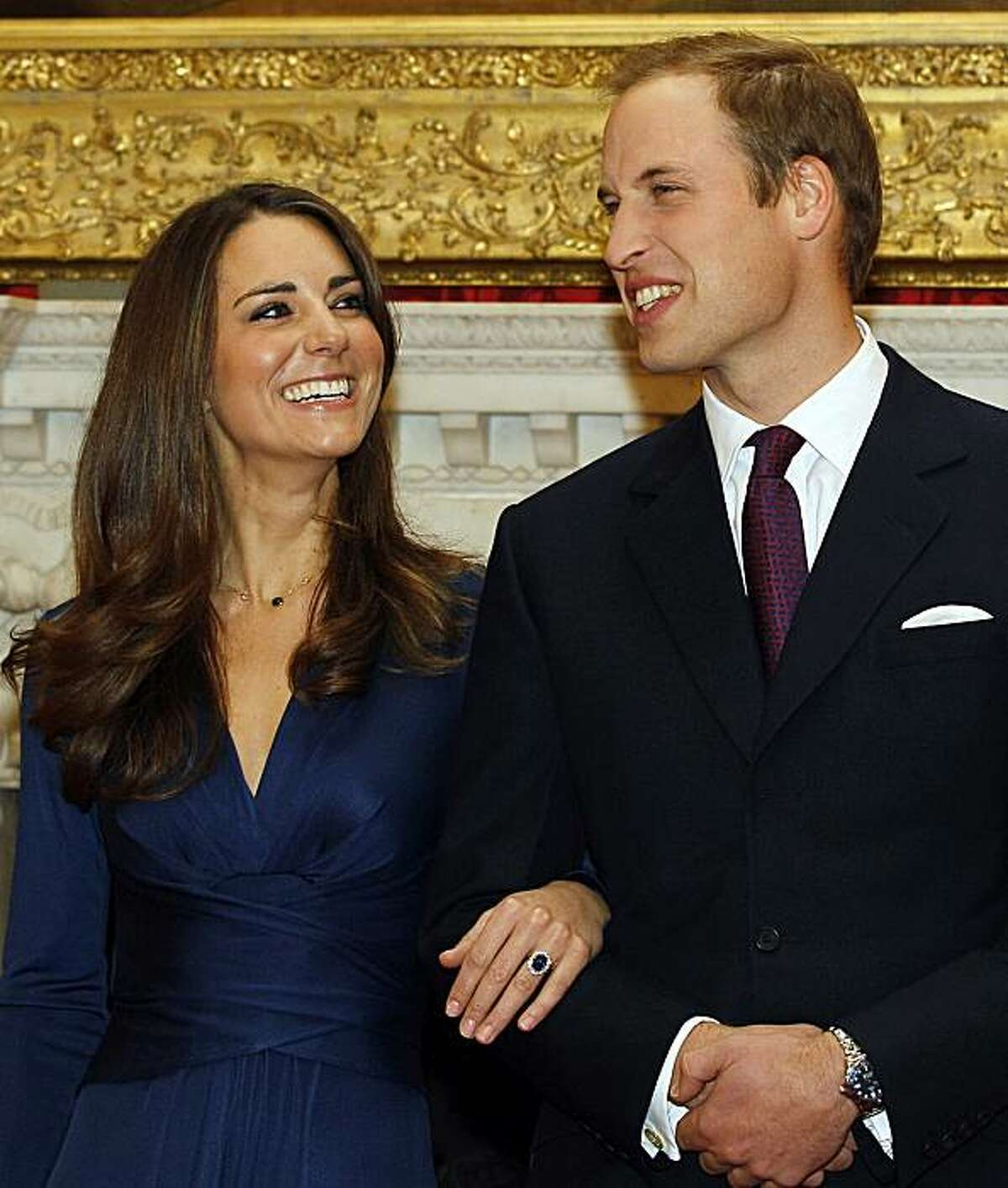 FILE - In this Nov. 16, 2010 file photo, Britain's Prince William and his fiancee Kate Middleton pose for the media at St. James's Palace in London, after they announced their engagement. Palace officials have announced Wednesday Jan. 5, 2011 will preside at the April 29 wedding of Prince Charles and Kate Middleton.
