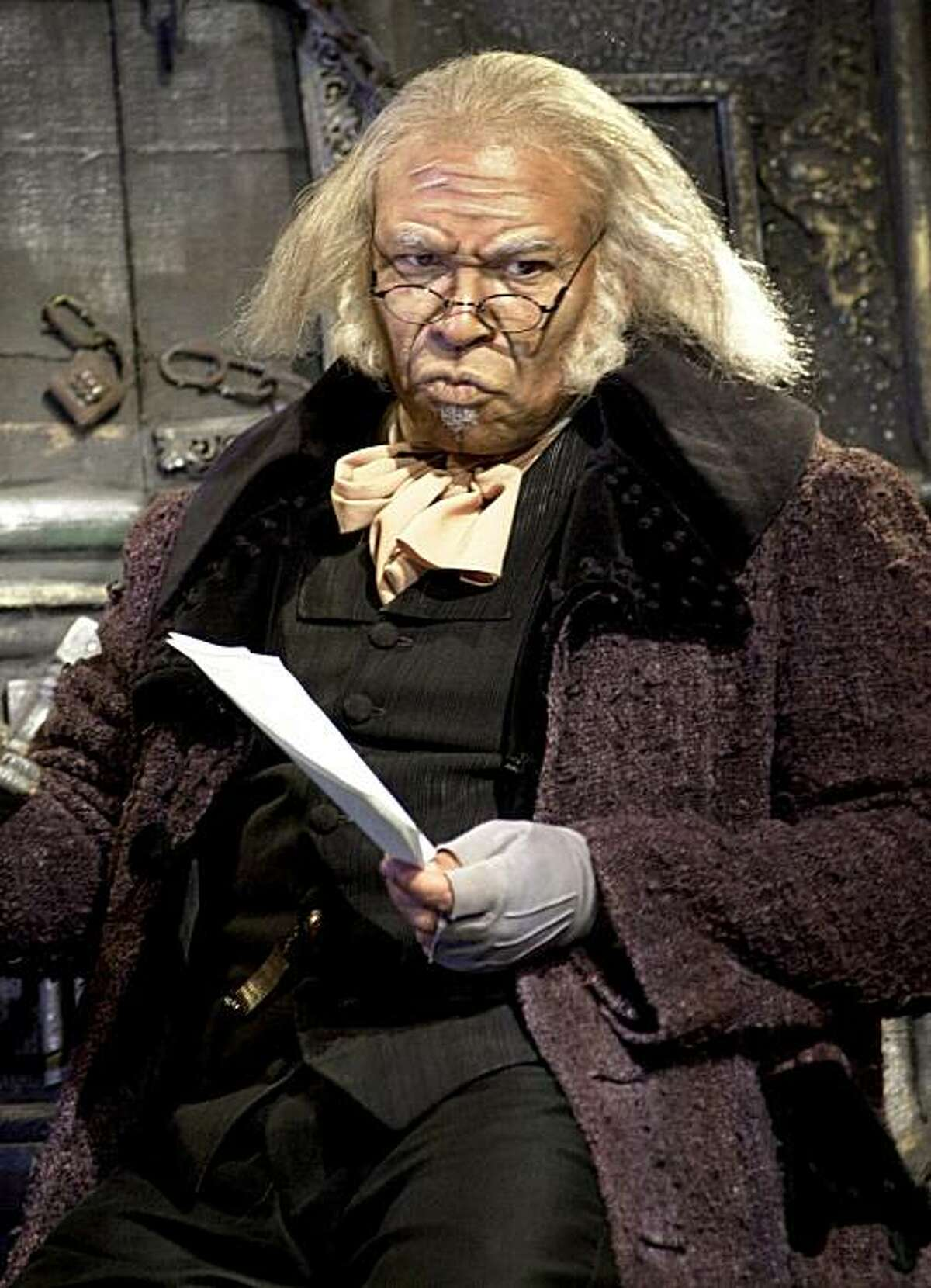 Steven Anthony Jones is the black man who plays an deliciously nasty Scrooge in