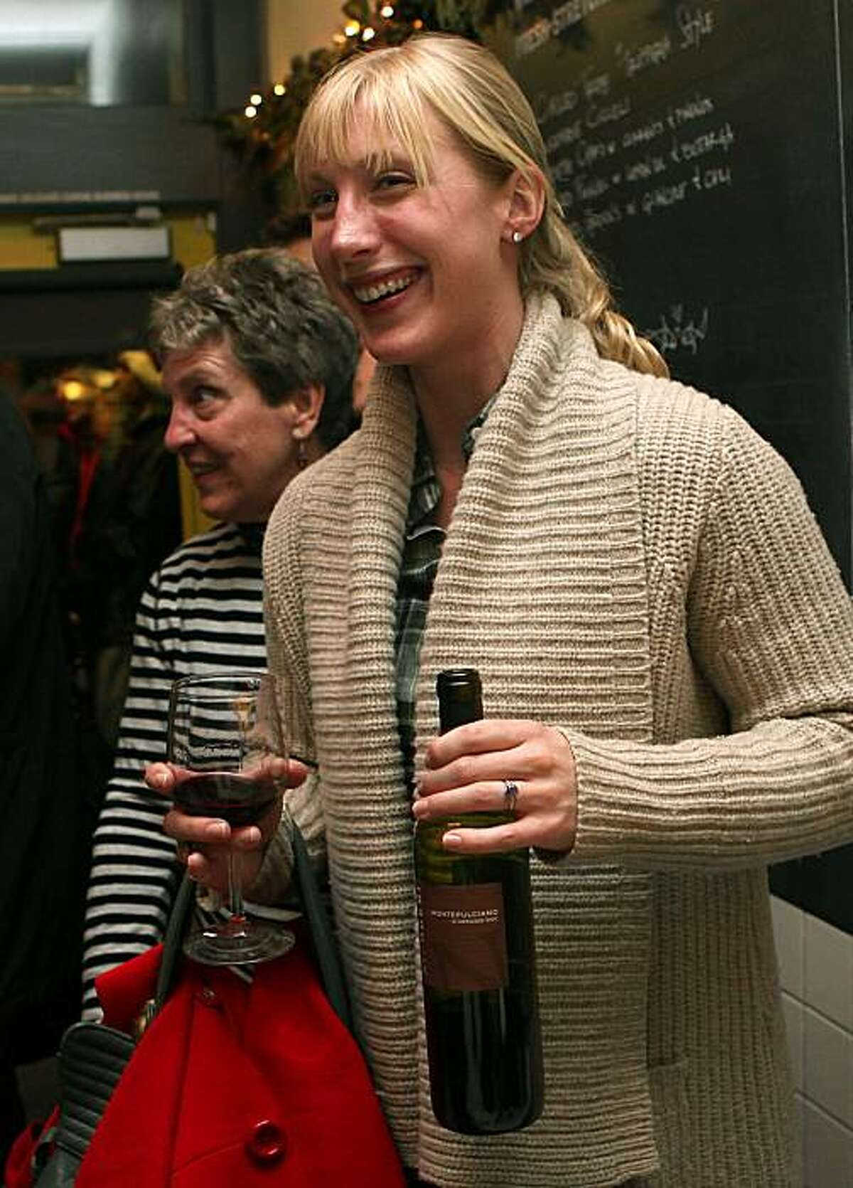 Kristen Rajagapal having a bottle of wine with her visiting mom Rome Brumfield from Pebble Beach as they wait in line at Delfina's Pizzeria in San Francisco, Calif., on Thursday, December 30, 2010.
