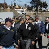 Governor Arnold Schwarzenegger, (center) is joined by the Secretary of California Emergency Management Agency, Matt Bettenhausen, (left) along with other officials, as they visit the site of last weeks natural gas explosion on Wednesday Sept. 15, 2010,  in San Bruno, Calif.