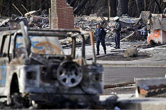 Police officer patrol the explosion site, Tuesday Sept. 14, 2010,  in San Bruno, Calif. Photo: Lacy Atkins, The Chronicle