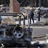 Police officer patrol the explosion site, Tuesday Sept. 14, 2010,  in San Bruno, Calif.