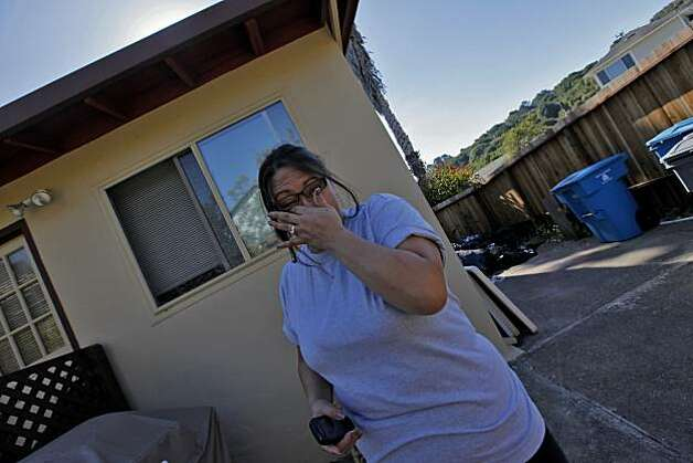 "Robin Melendez react as she thinks of how close her home was to last weeks inferno, Tuesday Sept. 14, 2010, in San Bruno, Calif."" I literally thought I was going to die, but my father is my angel and saved me,"" said Robin. Her father died July 26th of this year. Photo: Lacy Atkins, The Chronicle"