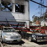Damaged cars in the driveway of a home on Glenview Drive in San Bruno on Saturday.