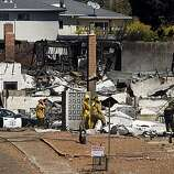 Authorities search through the rubble of a home on Glenview Drive in San Bruno on Saturday.