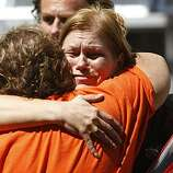 Unidentified people hug as they reunite the day after the explosion at the San Bruno Recreation Center, Sept. 10, 2010, in San Bruno, Calif.  An explosion destroyed a reported 38 homes damaging more, causing a confirmed 4 fatalities, and displacing many families.