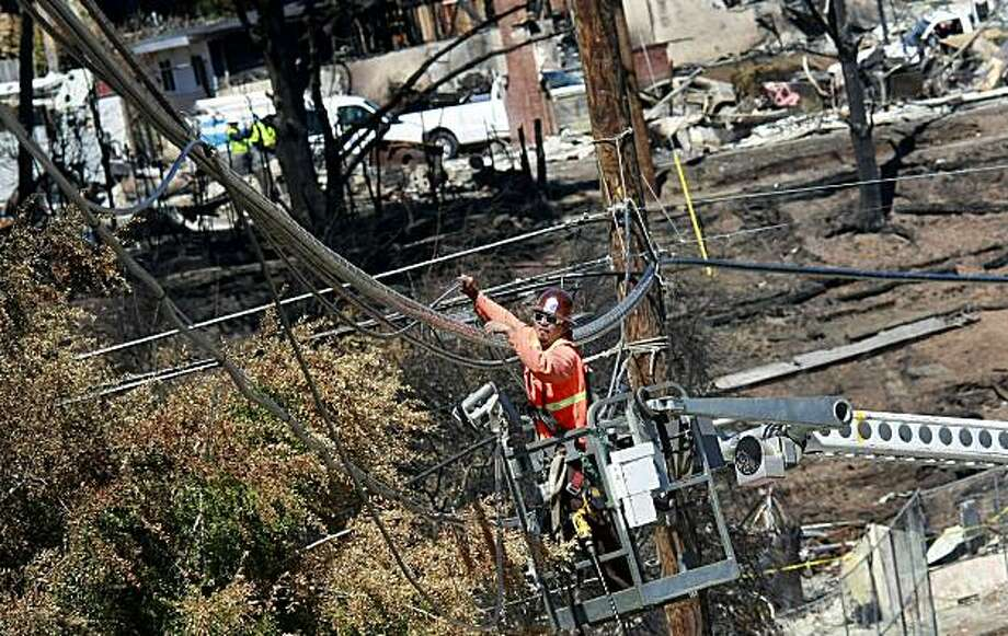 PG&E workers were busy with power line completion, this one being on Glenview Drive. First responders to the San Bruno, Calif. pipeline explosion talked about their experiences Tuesday September 14, 2010. Photo: Brant Ward, The Chronicle