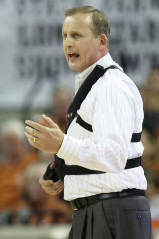 University of Texas head coach Rick Barnes calls out a play, during the second half against Texas A&M at the Frank Erwin Center in Austin, Texas, Wednesday, Jan. 11, 2012. The Longhorns won 61-51. JERRY LARA/glara@express-news.net Photo: JERRY LARA, Express-News / SAN ANTONIO EXPRESS-NEWS