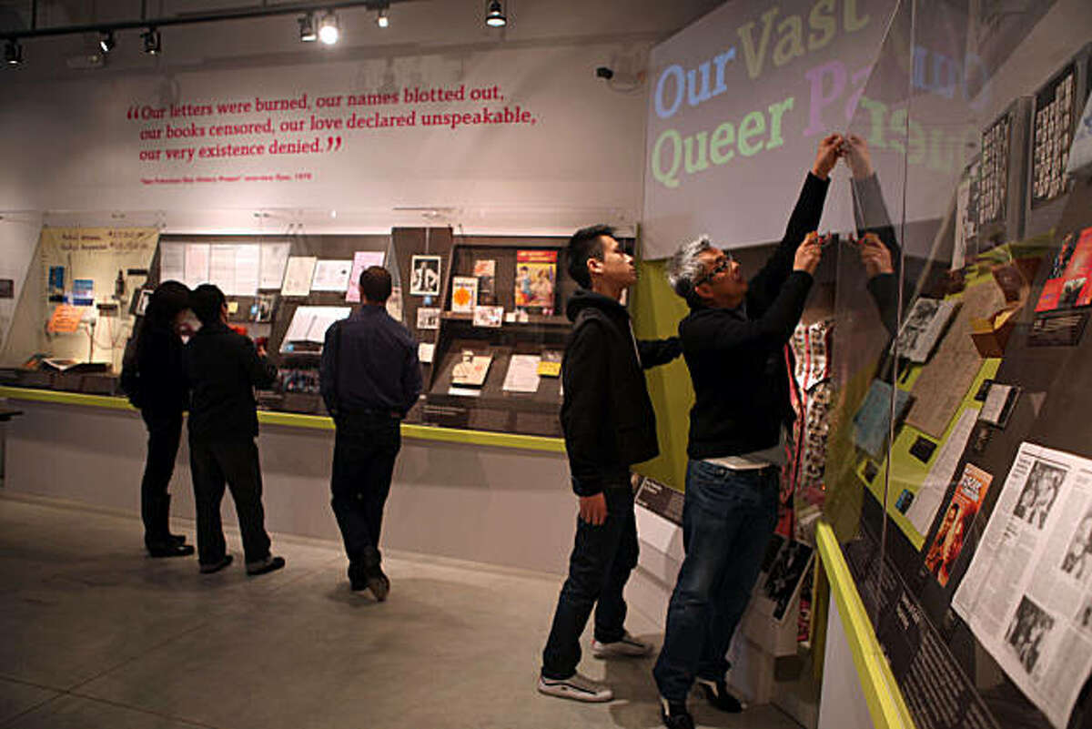 The GLBT (gay, lesbian, bisexual, transexual) history museum will open tomorrow in the Castro in San Francisco, Calif., as exhibition consultant Ramone Silvestre (right) and volunteer Hin Leung (middle, right) do last minute preparations on Tuesday, January 11, 2011.