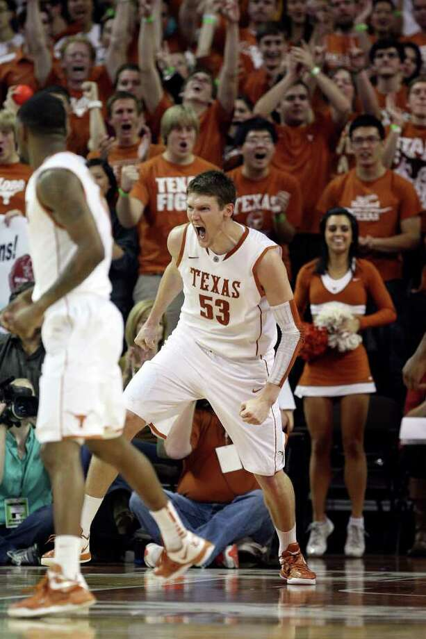 University of Texas Longhorns center Clint Chapman celebrates an alley-oop dunk against Texas A&M, during the second half at the Frank Erwin Center in Austin, Texas, Wednesday, Jan. 11, 2012. The Longhorns won 61-51. JERRY LARA/glara@express-news.net Photo: JERRY LARA, Express-News / SAN ANTONIO EXPRESS-NEWS